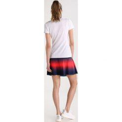 Colmar MINERAL Koszulka sportowa white/navy. Białe bluzki sportowe damskie Colmar, s, z materiału, polo. W wyprzedaży za 367,20 zł.