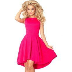 66-3 gruba lacosta - ekskluzywna sukienka z dłuższym tyłem - malina. Różowe sukienki z falbanami marki numoco, l, z dekoltem w łódkę, oversize. Za 137,00 zł.