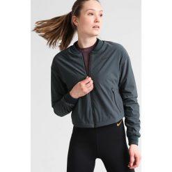 Nike Performance Kurtka zimowa seaweed/hasta/barely volt/reflective black. Zielone kurtki sportowe damskie Nike Performance, na zimę, l, z elastanu. W wyprzedaży za 351,45 zł.