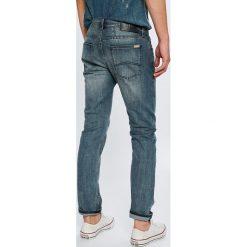 Armani Exchange - Jeansy. Niebieskie jeansy męskie relaxed fit marki House, z jeansu. Za 439,90 zł.