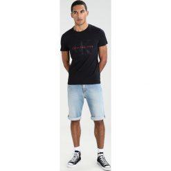 Calvin Klein Jeans TAMASY SLIM FIT TEE Tshirt z nadrukiem ck black. Czarne koszulki polo Calvin Klein Jeans, m, z nadrukiem, z bawełny. Za 229,00 zł.