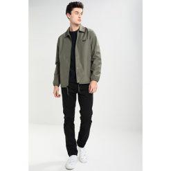 Nudie Jeans SLIM ADAM Jeansy Slim Fit black. Czarne jeansy męskie relaxed fit marki Criminal Damage. W wyprzedaży za 463,20 zł.