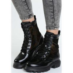 Czarne Traperki In The Sky. Czarne buty zimowe damskie Born2be, ze skóry, przed kolano, na wysokim obcasie. Za 129,99 zł.