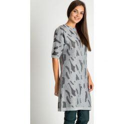 Długi szary sweter w formie tuniki QUIOSQUE. Szare tuniki damskie z długim rękawem QUIOSQUE, na co dzień, na jesień, s, klasyczne, z klasycznym kołnierzykiem. W wyprzedaży za 99,99 zł.