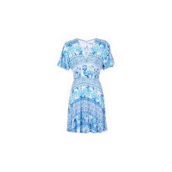 Sukienki krótkie Desigual  DEFREA. Niebieskie sukienki mini marki Desigual, l, z krótkim rękawem. Za 307,30 zł.