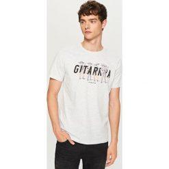 T-shirt z napisem - Kremowy. Białe t-shirty męskie marki INESIS, m, z bawełny, z długim rękawem. Za 29,99 zł.