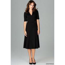 Sukienka K478 Czarny. Czarne sukienki na komunię marki Pakamera, dekolt w kształcie v, midi. Za 179,00 zł.