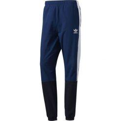 Adidas Spodnie damskie Blocked Wind niebieski r. M (BJ8747). Niebieskie spodnie sportowe damskie marki Adidas, m. Za 307,80 zł.