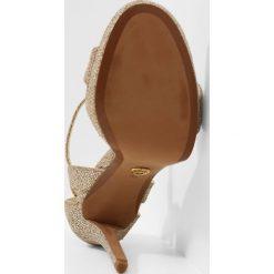 MICHAEL Michael Kors TAMRA PLATFORM Sandały na obcasie silver/sand. Czarne sandały damskie marki MICHAEL Michael Kors, z gumy, przed kolano, na wysokim obcasie. W wyprzedaży za 575,20 zł.