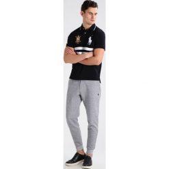 Spodnie dresowe męskie: Polo Ralph Lauren Spodnie treningowe vintage salt