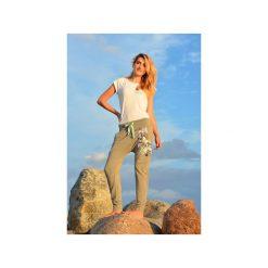 Spodnie damskie - Szare kwiaty - baggy - joggery. Niebieskie spodnie ciążowe marki bonprix, w paski, z dżerseju. Za 199,00 zł.