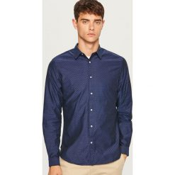 Koszula slim fit z bawełny strukturalnej - Granatowy. Niebieskie koszule męskie slim marki Reserved, l, z bawełny. Za 99,99 zł.