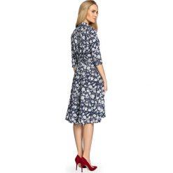 ALMA Zwiewna sukienka z wiązaniem - granatowa. Niebieskie sukienki hiszpanki Stylove, z nadrukiem, midi. Za 199,00 zł.