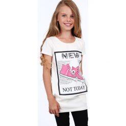 Tunika dziewczęca z aplikacją kremowa NDZ8178. Białe sukienki dziewczęce z falbanami Fasardi, z aplikacjami. Za 39,00 zł.