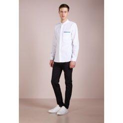 PS by Paul Smith Jeansy Slim Fit darkblue denim. Niebieskie jeansy męskie relaxed fit marki PS by Paul Smith. W wyprzedaży za 434,85 zł.