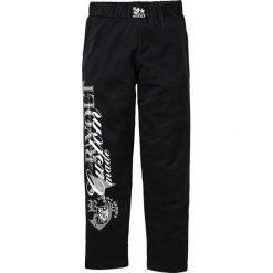 Spodnie dresowe bonprix czarny. Czarne spodnie dresowe męskie bonprix, z aplikacjami, z dresówki. Za 59,99 zł.