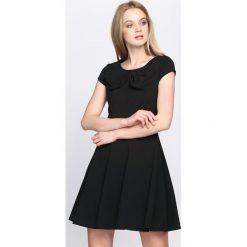 Czarna Sukienka Treat Me. Czarne sukienki letnie marki Born2be, s, mini. Za 89,99 zł.
