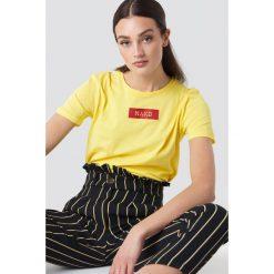 NA-KD T-shirt NA-KD Logo - Yellow. Żółte t-shirty damskie NA-KD, z klasycznym kołnierzykiem. W wyprzedaży za 42,67 zł.