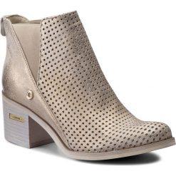 Botki CARINII - B3983  F76-000-000-861. Żółte buty zimowe damskie Carinii, z nubiku. W wyprzedaży za 229,00 zł.