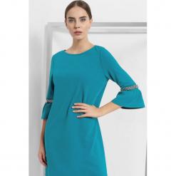 Luźna sukienka z koralikami. Brązowe sukienki dzianinowe marki Orsay, s. Za 119,99 zł.