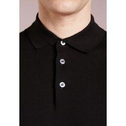 Drumohr Koszulka polo nero. Białe koszulki polo marki Bambi, l, z nadrukiem, z okrągłym kołnierzem. W wyprzedaży za 499,50 zł.