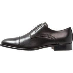 Florsheim RAVEL Eleganckie buty black. Czarne buty wizytowe męskie Florsheim, z materiału, na sznurówki. Za 779,00 zł.