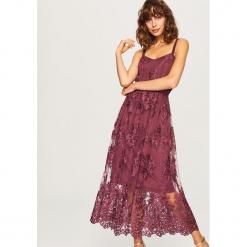 Koronkowa sukienka midi - Fioletowy. Czarne sukienki koronkowe marki numoco, l, z długim rękawem, midi, oversize. Za 229,99 zł.