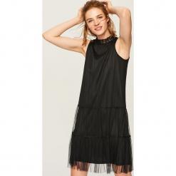 Tiulowa sukienka - Czarny. Czarne sukienki marki Reserved, z lyocellu. Za 79,99 zł.