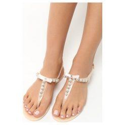 Beżowe Sandały Roundup. Brązowe sandały damskie marki Born2be, z gumy, na obcasie. Za 39,99 zł.