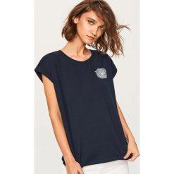 T-shirt z nadrukiem - Granatowy. Niebieskie t-shirty damskie Reserved, l, z nadrukiem. Za 29,99 zł.
