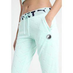Fenty PUMA by Rihanna FITTED TRACK PANT Spodnie treningowe bay. Zielone bryczesy damskie Fenty PUMA by Rihanna, l, z bawełny. Za 719,00 zł.