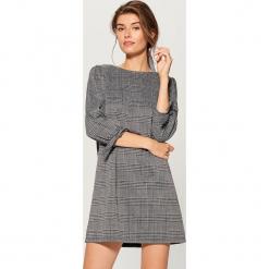 Sukienka mini w kratkę - Czarny. Sukienki małe czarne marki numoco, l, z długim rękawem, oversize. Za 99,99 zł.