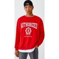 Bluza z literami. Czerwone bluzy męskie rozpinane marki KALENJI, m, z elastanu, z długim rękawem, długie. Za 59,90 zł.
