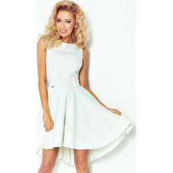 Monica Ekskluzywna sukienka z dłuższym tyłem - ECRU. Szare sukienki z falbanami numoco. Za 159,99 zł.