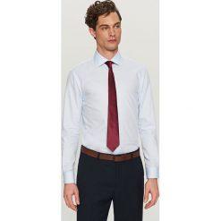 Bawełniana koszula regular fit - Niebieski. Niebieskie koszule męskie marki Reserved, m, z bawełny. W wyprzedaży za 69,99 zł.