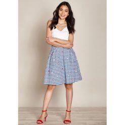 Minispódniczki: Rozszerzana spódnica w kratkę