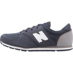 New Balance Tenisówki i Trampki navy. Szare tenisówki męskie marki New Balance, na lato, z materiału. W wyprzedaży za 149,40 zł.