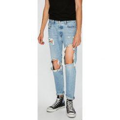 Diesel - Jeansy Mharky. Szare jeansy męskie slim marki Diesel. W wyprzedaży za 679,90 zł.