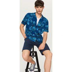 Koszule męskie na spinki: Koszula z roślinnym nadrukiem regular fit – Granatowy