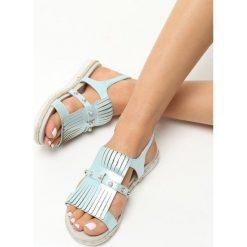 Niebieskie Sandały Tendril. Niebieskie sandały damskie Born2be, z materiału, na płaskiej podeszwie. Za 49,99 zł.
