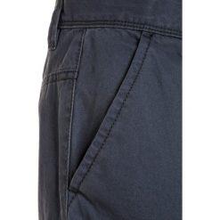 Benetton TROUSERS Bojówki blue. Niebieskie spodnie chłopięce marki Benetton, z bawełny. Za 129,00 zł.