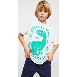 Mango Kids - T-shirt dziecięcy Dino 104-164 cm. Szare t-shirty chłopięce z nadrukiem marki Mango Kids, z bawełny, z okrągłym kołnierzem. W wyprzedaży za 19,90 zł.
