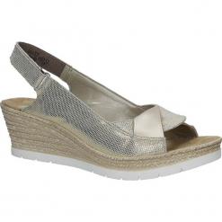 Złote sandały błyszczące na koturnie Rieker 61972-90. Żółte sandały damskie marki Kazar, ze skóry, na wysokim obcasie, na obcasie. Za 238,99 zł.