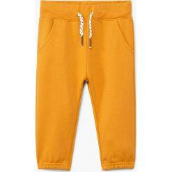 Chinosy chłopięce: Mango Kids - Spodnie dziecięce Mateop 80-104 cm