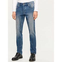 Jeansy slim fit - Granatowy. Niebieskie jeansy męskie regular Reserved. Za 149,99 zł.