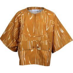 Adidas Koszulka damska Stella McCartney Run Nylon Tee pomarańczowa r. M  (M61152). Brązowe topy sportowe damskie Adidas, m, z nylonu. Za 73,80 zł.