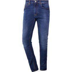 Vivienne Westwood Anglomania Jeans Skinny Fit blue denim. Niebieskie rurki męskie marki Tiffosi. W wyprzedaży za 509,50 zł.
