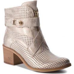 Botki CARINII - B4441 F76-000-000-861. Żółte buty zimowe damskie Carinii, ze skóry. W wyprzedaży za 279,00 zł.