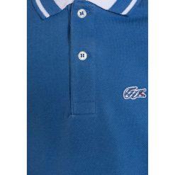 Lacoste Koszulka polo plongeon/blanc. Niebieskie bluzki dziewczęce bawełniane marki Lacoste. W wyprzedaży za 171,75 zł.