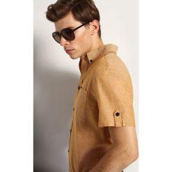 KOSZULA KRÓTKI RĘKAW MĘSKA SLIM FIT. Brązowe koszule męskie slim marki QUECHUA, m, z elastanu, z krótkim rękawem. Za 39,99 zł.